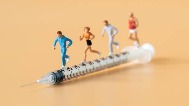 Sport Corona-Impfung Symbolbild
